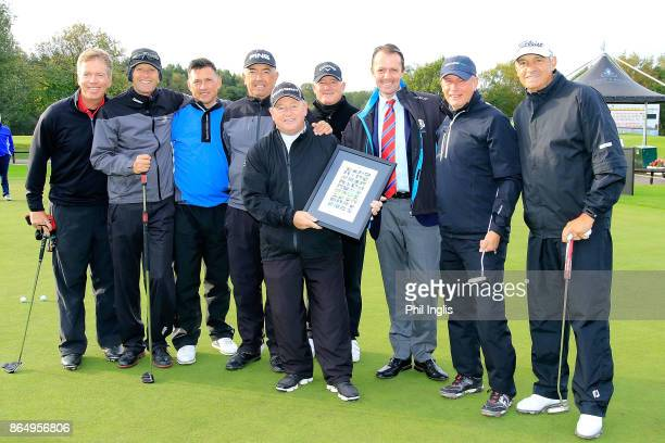 Ian Woosnam of Wales is presented with a memento of his recent induction to World Golf Hall of Fame by David MacLaren Head of European Senior Tour...