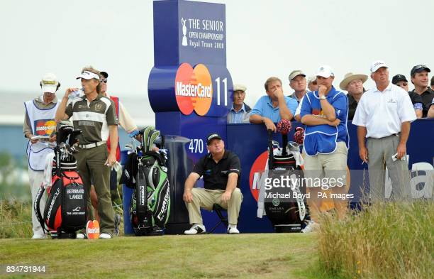 Ian Woosnam sits as Langer and O'Meara wait during the Britsih Seniors Open Royal Troon Golf Club Ayrshire