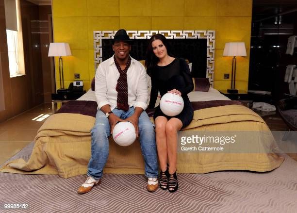 Ian Wright and Kirsty Gallacher attend a photocall to launch Lastminutecom's World Cup offers at The May Fair Hotel on May 19 2010 in London England