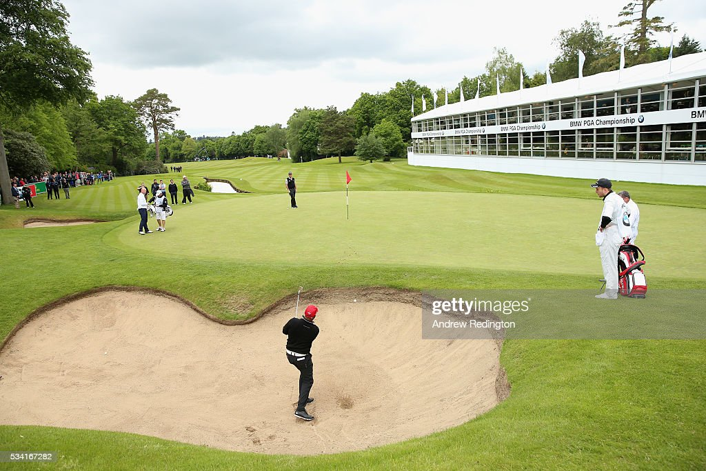 <a gi-track='captionPersonalityLinkClicked' href=/galleries/search?phrase=Ian+Wright&family=editorial&specificpeople=221321 ng-click='$event.stopPropagation()'>Ian Wright</a> hits from a bunker on the 18th hole during the Pro-Am prior to the BMW PGA Championship at Wentworth on May 25, 2016 in Virginia Water, England.