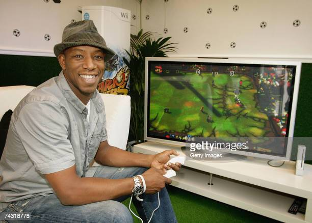 Ian Wright launches the first WiFi game Mario Strikers Charged Football on Nintendo's Wii console at GAME Oxford Street on May 25 2007 in London 100...