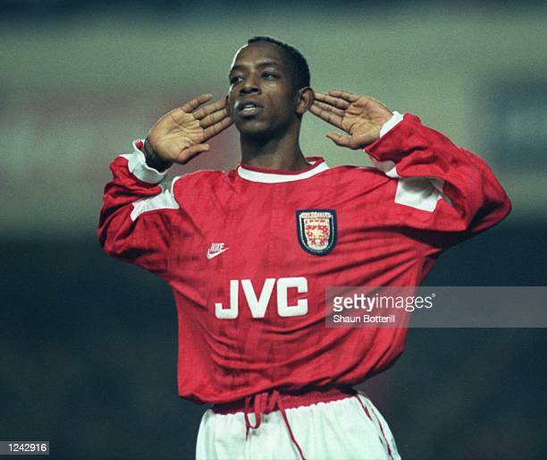 Ian Wright of Arsenal listens to the cheers of the supporters after he scored in the Coca Cola Cup quarter final match against Newcastle at Highbury