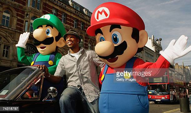 Ian Wright poses with Mario and Luigi as he launches the first WiFi game Mario Strikers Charged Football on Nintendo's Wii console at GAME Oxford...