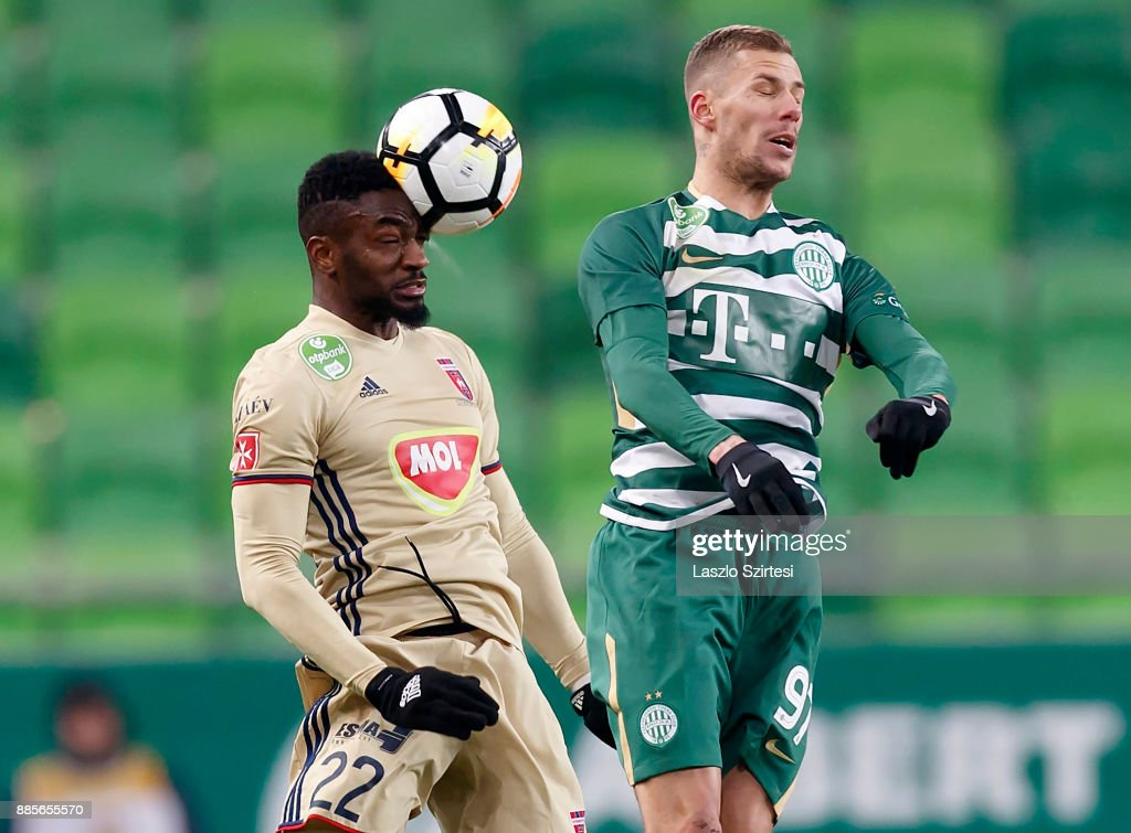 Ianique dos Santos Tavares 'Stopira' #22 of Videoton FC wins the ball in the air from Roland Varga #97 of Ferencvarosi TC during the Hungarian OTP Bank Liga match between Ferencvarosi TC and Videoton FC at Groupama Arena on December 2, 2017 in Budapest, Hungary.