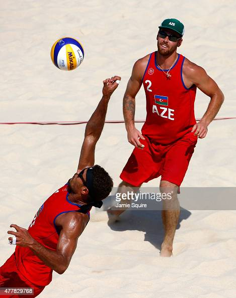 Iaroslav Rudykh of Azerbaijan watches as teammate Neilton Santos returns the ball in the Beach Volleyball quarterfinals during day eight of the Baku...