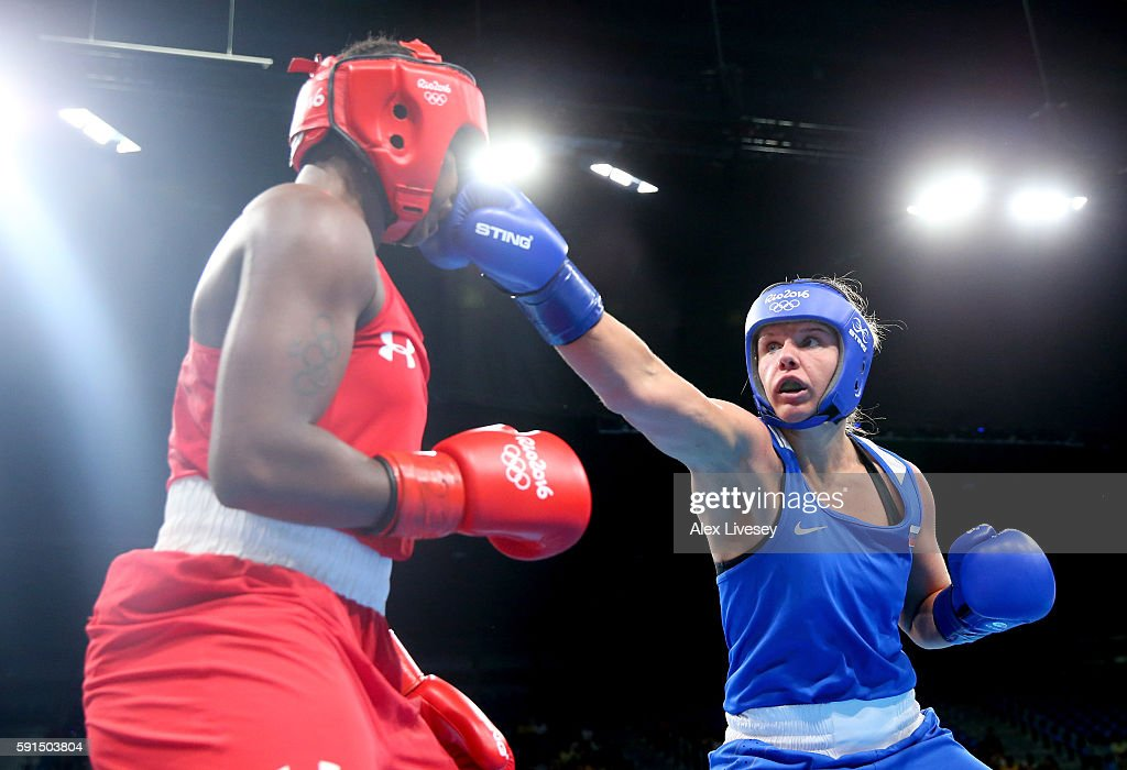 Iaroslava Iakushina of Russia throws a right to the face of Claresa Maria Shields of the United States during the Women's Middleweight Quarterfinal...