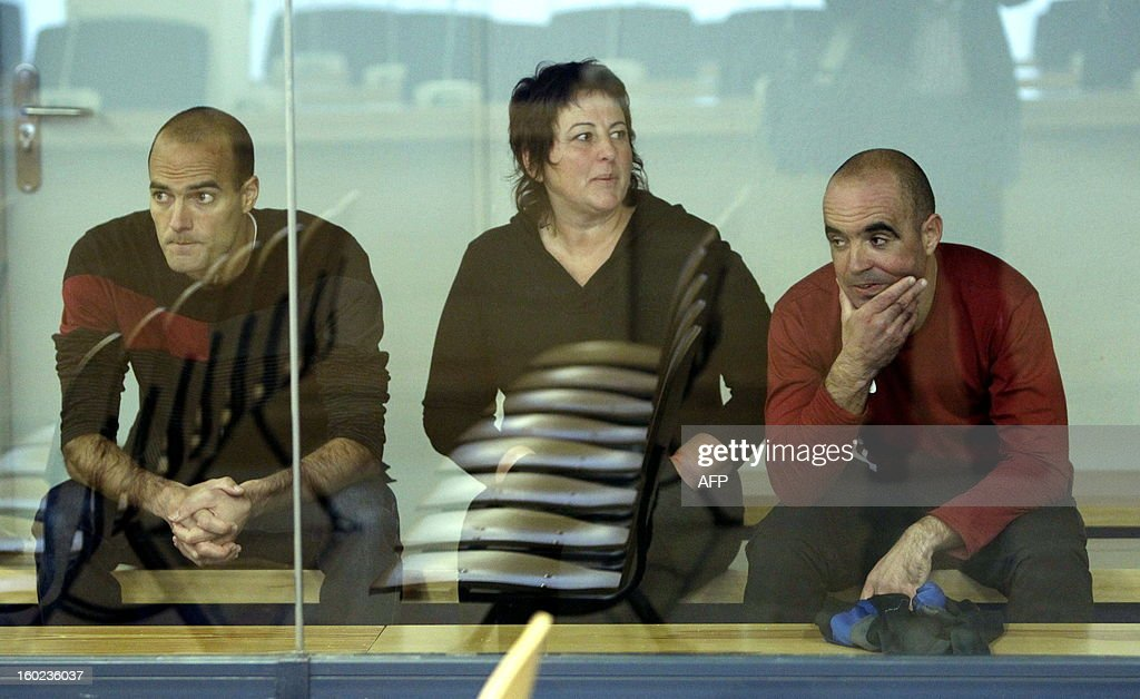 Ibai Beobide (L), Miren Josune Balda (C) and Jose Agustin Camacho (R), suspected members of the Basque separatist group ETA, attend their trial for 'membership and collaboration in a terrorist organization', possession of explosives and depot weapons at the National Court in Madrid on January 28, 2013.
