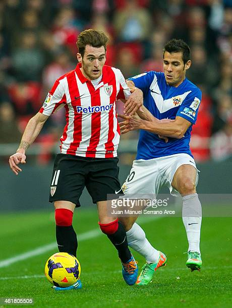 Ibai Gomez of Athletic Club Bilbao competes for the ball with Rafael Ramos of UD Almeria during the La Liga match between Athletic Club Bilbao and UD...