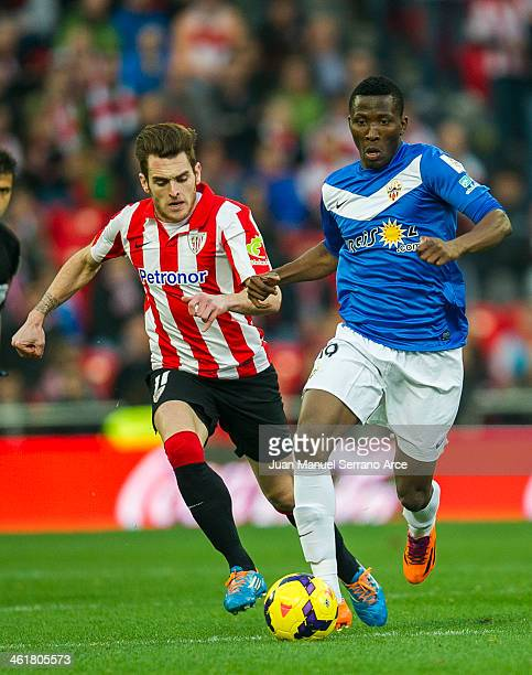 Ibai Gomez of Athletic Club Bilbao competes for the ball with Jonathan Zongo of UD Almeria during the La Liga match between Athletic Club Bilbao and...
