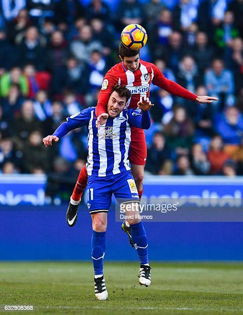 Ibai Gomez of Deportivo Alaves competes for a high ball with Sime Vrsaljko of Club Atletico de Madrid during the La Liga match between Deportivo...