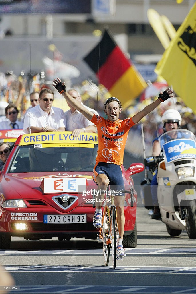 L'HALPE D'HUEZ FRANCE JULY 13 Iban Mayo of Spain riding for the EuskatelEuskadi team rides victorious at the finish line after winning stage 8...