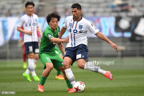 Ibba of Yokohama FC and Yoshiaki Takagi of Tokyo Verdy compete for the ball during the JLeague J2 match between Tokyo Verdy and Yokohama FC at...
