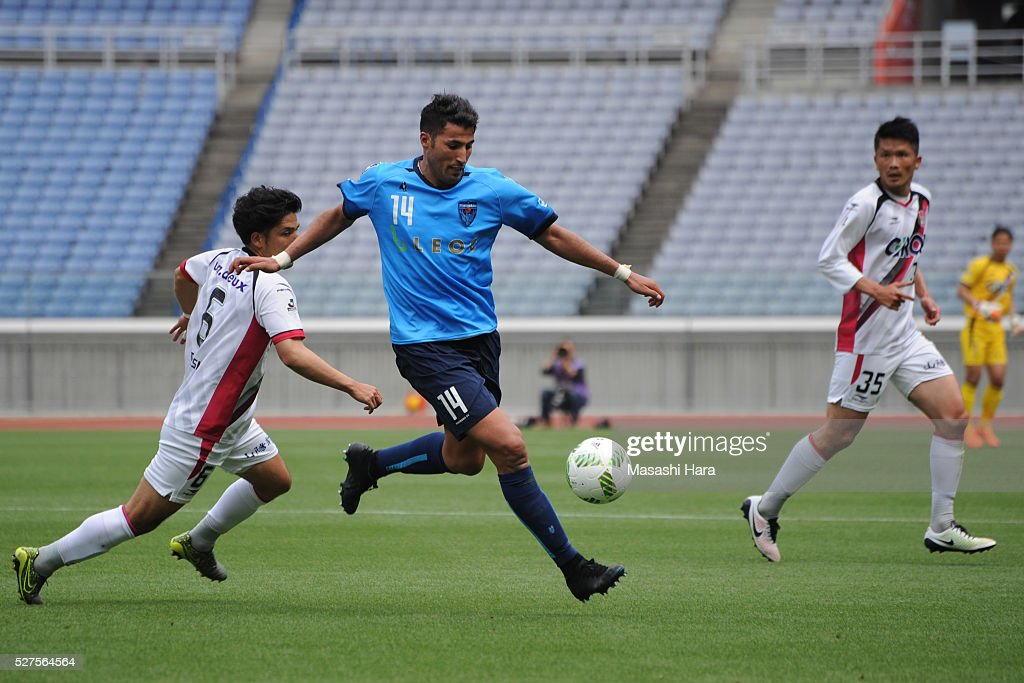 Ibba #14 of Yokohama FC in action during the J.League second division match between Yokohama FC and Fagiano Okayama at the Nissan Stadium on May 3, 2016 in Yokohama, Kanagawa, Japan.