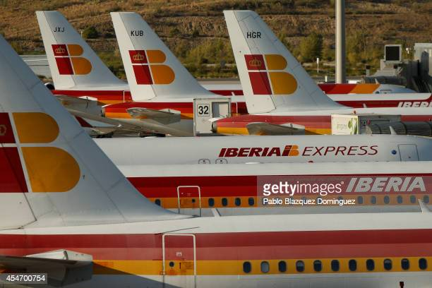 Iberia airplanes are parked at Adolfo Suarez Madrid Barajas Airport on September 5 2014 in Madrid Spain Iberia British Airway's partner in IAG is on...