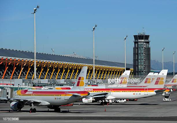 Iberia airplanes stand on the tarmac on December 4 2010 in Madrid Spain Airtraffic in Spain has come to a virtual stand still due to a wild strike by...