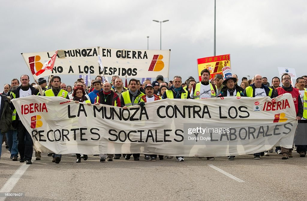 Iberia workers march towards Barajas airport during a strike on March 4, 2013 in Madrid, Spain. Iberia workers have begun the second round of five day strikes in protest at plans by holding company IAG (International Consolidated Airlines Group), formed by the 2011 merger of Iberia and British Airways, to implement redundancies and pay cuts across the troubled Spanish airline.