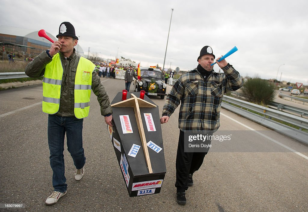 Iberia workers wearing mock British policeman's helmets carry a coffin containing an effigy representing the historical figure of English Vice Admiral Sir Francis Drake, as they protest during the march near Barajas Airport on March 4, 2013 in Madrid, Spain. Iberia workers have begun the second round of five day strikes in protest at plans by holding company IAG (International Consolidated Airlines Group), formed by the 2011 merger of Iberia and British Airways, to implement redundancies and pay cuts across the troubled Spanish airline. The strike is estimated to cause the cancelling almost 1,300 flights this week, with a final round of five day strikes planned for March 18 to 22.