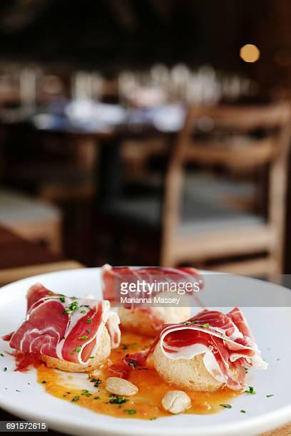 Iberico Ham served on a crostini