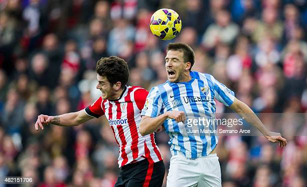 Ibia Gomez of Athletic Club duels for the ball withÊIgnacio Camacho of Malaga CF during the La Liga match between Athletic Club and Malaga CF at San...