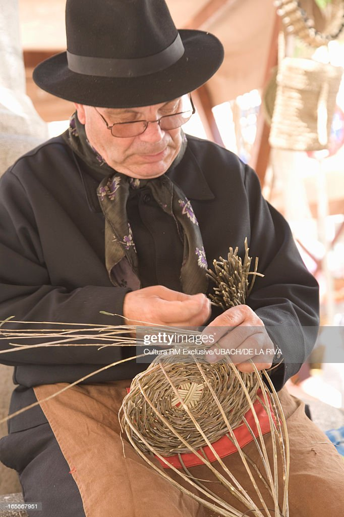 Ibiza man weaving basket