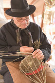 Ibiza man weaving basket
