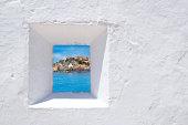 Ibiza mediterranean white wall window with Eivissa town view