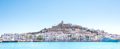 Beautiful light of the sun over the city of Ibiza in pamorma format