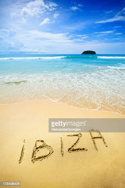 Ibiza written in the sand of a tropical beach