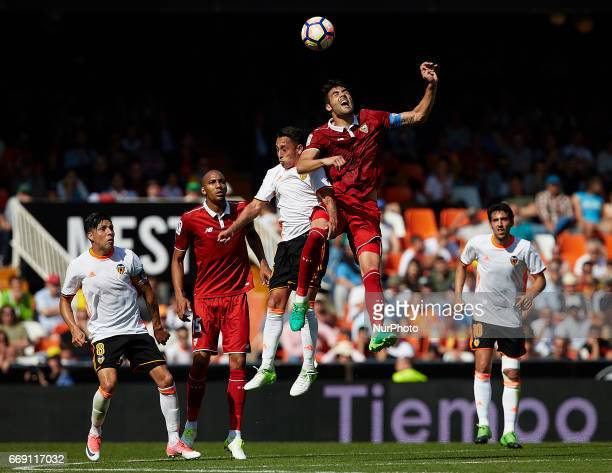 Iborra of Sevilla FC heads the ball next to Fabian Orellana of Valencia CF during the La Liga match between Valencia CF and Sevilla FC at Mestalla...