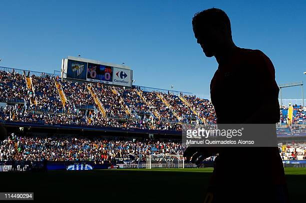 Ibrahim Afellay of Barcelona trudges off the pitch before the La Liga match between Malaga and Barcelona at La Rosaleda Stadium on May 21 2011 in...