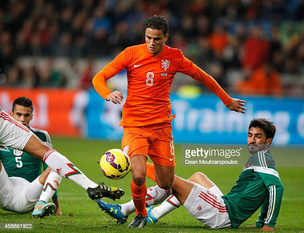 Ibrahim Afellay of Netherlands and Adrian Aldrete and Diego Reyes of Mexico battle for the ball during the international friendly match between...