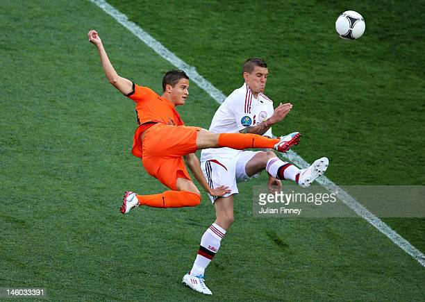 Ibrahim Afellay of Netherlands and Daniel Agger of Denmark compete for the ball during the UEFA EURO 2012 group B match between Netherlands and...