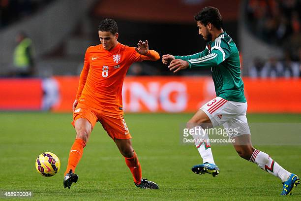 Ibrahim Afellay of Netherlands and Oswaldo Alanis of Mexico battle for the ball during the international friendly match between Netherlands and...