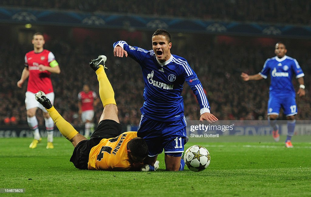 Ibrahim Afellay of Schalke 04 is challenged by Vito Mannone of Arsenal in the penalty area during the UEFA Champions League Group B match between Arsenal and FC Schalke at the Emirates Stadium on October 24, 2012 in London, England.