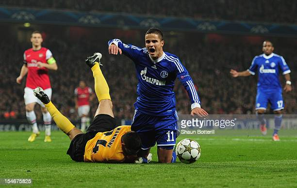 Ibrahim Afellay of Schalke 04 is challenged by Vito Mannone of Arsenal in the penalty area during the UEFA Champions League Group B match between...
