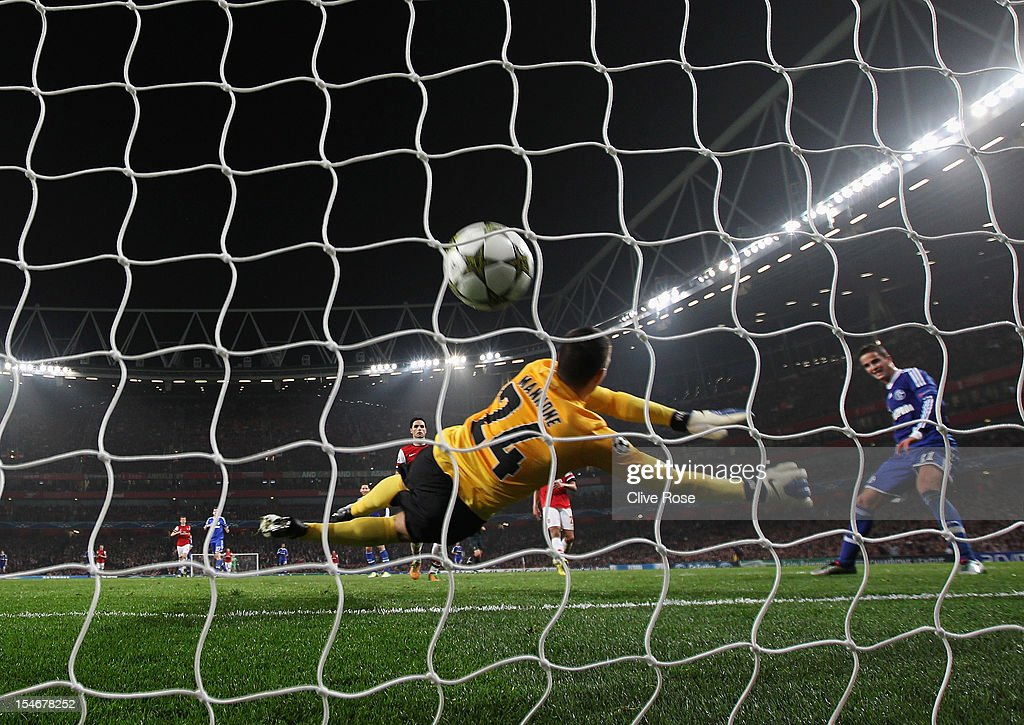 <a gi-track='captionPersonalityLinkClicked' href=/galleries/search?phrase=Ibrahim+Afellay&family=editorial&specificpeople=837737 ng-click='$event.stopPropagation()'>Ibrahim Afellay</a> of Schalke 04 shoots past <a gi-track='captionPersonalityLinkClicked' href=/galleries/search?phrase=Vito+Mannone&family=editorial&specificpeople=4174200 ng-click='$event.stopPropagation()'>Vito Mannone</a> of Arsenal to score their second goal during the UEFA Champions League Group B match between Arsenal and FC Schalke at the Emirates Stadium on October 24, 2012 in London, England.