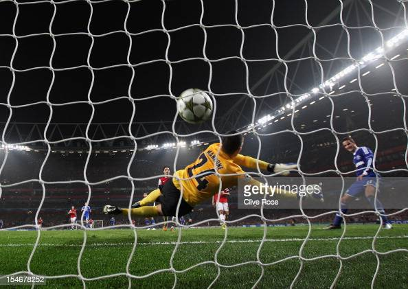 Ibrahim Afellay of Schalke 04 shoots past Vito Mannone of Arsenal to score their second goal during the UEFA Champions League Group B match between...