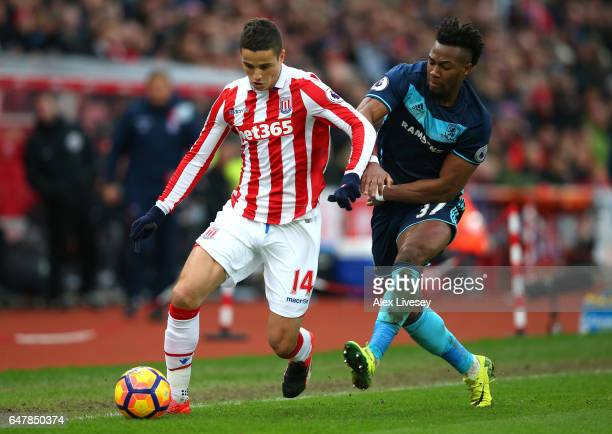 Ibrahim Afellay of Stoke City and Adama Traore of Middlesbrough battle for possession during the Premier League match between Stoke City and...