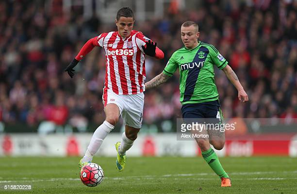 Ibrahim Afellay of Stoke City and Jordy Clasie of Southampton during the Barclays Premier League match between Stoke City and Southampton at...