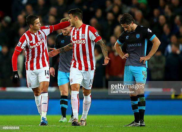 Ibrahim Afellay of Stoke City celebrates his goal with Joselu of Stoke City during the Capital One Cup match between Stoke City and Sheffield...