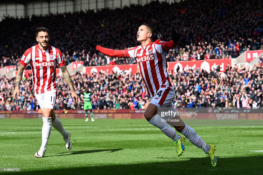 <a gi-track='captionPersonalityLinkClicked' href=/galleries/search?phrase=Ibrahim+Afellay&family=editorial&specificpeople=837737 ng-click='$event.stopPropagation()'>Ibrahim Afellay</a> of Stoke City celebrates scoring his team's first goal during the Barclays Premier League match between Stoke City and Swansea City at Britannia Stadium on April 2, 2016 in Stoke on Trent, England.