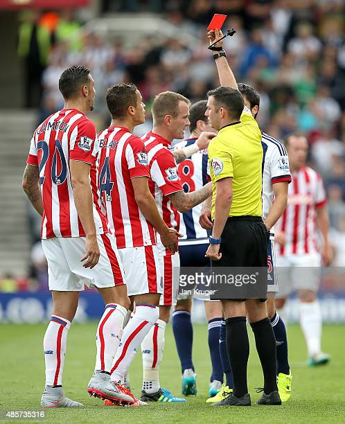 Ibrahim Afellay of Stoke City is shown the red card by referee Michael Oliver during the Barclays Premier League match between Stoke City and West...