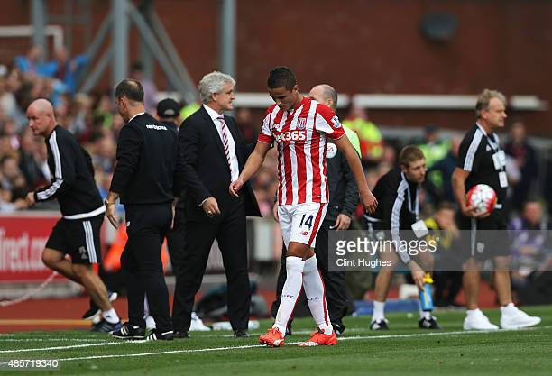 Ibrahim Afellay of Stoke City leaves the pitch after being shown a red card during the Barclays Premier League match between Stoke City and West...