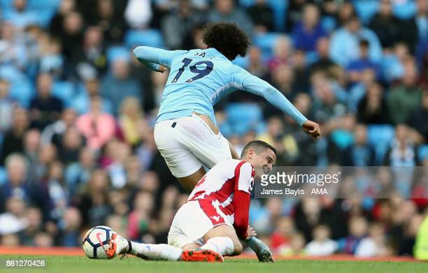 Ibrahim Afellay of Stoke City rugby tackles Leroy Sane of Manchester City during the Premier League match between Manchester City and Stoke City at...