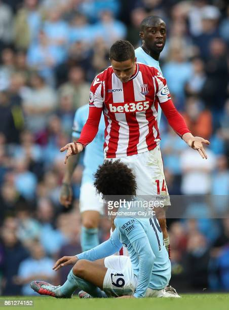 Ibrahim Afellay of Stoke City speaks with Leroy Sane of Manchester City during the Premier League match between Manchester City and Stoke City at...