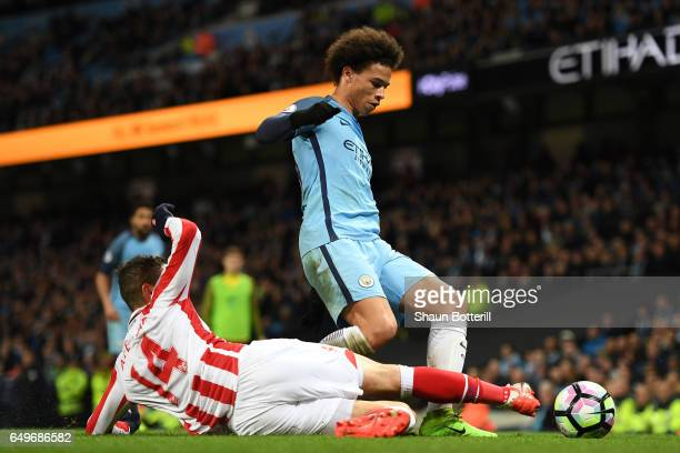 Ibrahim Afellay of Stoke City tackles Leroy Sane of Manchester City during the Premier League match between Manchester City and Stoke City at Etihad...