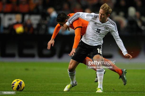 Ibrahim Affelay of Netherlands and Lewis Holtby of Germany battle for the ball during the International Friendly match between Netherlands and...