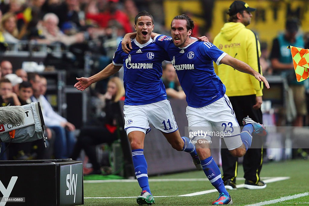 Ibrahim Affelay (L) of Schalke celebrates his team's first goal with team mate <a gi-track='captionPersonalityLinkClicked' href=/galleries/search?phrase=Christian+Fuchs&family=editorial&specificpeople=4143238 ng-click='$event.stopPropagation()'>Christian Fuchs</a> during the Bundesliga match between Borussia Dortmund and FC Schalke 04 at Signal Iduna Park on October 20, 2012 in Dortmund, Germany.