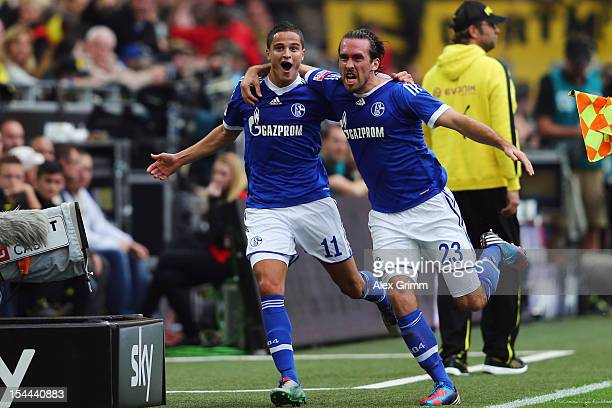 Ibrahim Affelay of Schalke celebrates his team's first goal with team mate Christian Fuchs during the Bundesliga match between Borussia Dortmund and...