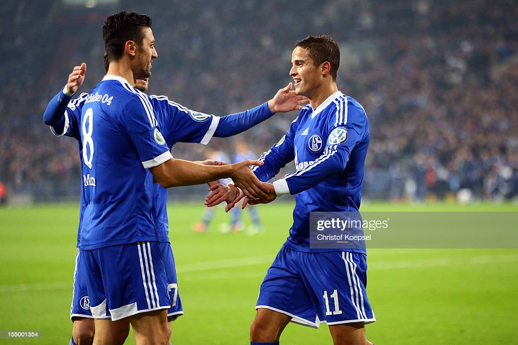 Ibrahim Affelay of Schalke (R) celebrates the first goal with <a gi-track='captionPersonalityLinkClicked' href=/galleries/search?phrase=Ciprian+Marica&family=editorial&specificpeople=2178476 ng-click='$event.stopPropagation()'>Ciprian Marica</a> of Schalke (L)during the DFB Cup second round match between FC Schalke 04 and SV Sandhausen at Veltins-Arena on October 30, 2012 in Gelsenkirchen, Germany.